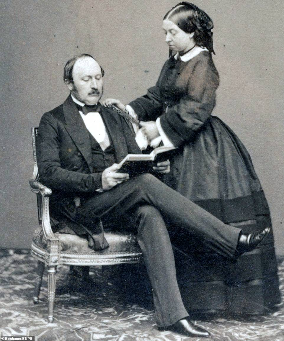 6420452 6409499 prince albert is pictured reading as queen victoria stands with a 37 1542714447657